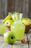 Apple juice. Fresh juice with green apple, selective focus Royalty Free Stock Photos