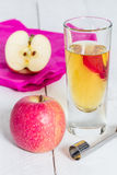 Apple juice freshly squeezed in glass on wood Royalty Free Stock Images