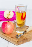 Apple juice freshly squeezed in glass on wood Royalty Free Stock Image