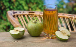 Apple juice  in the garden Stock Photography