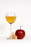 Apple juice. A glass of apple juice and an apple Stock Photography