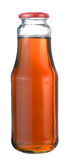 Apple juice in a glass bottle Royalty Free Stock Images