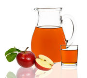 Apple juice in a glass and carafe Royalty Free Stock Photos