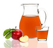 Apple juice in a glass and carafe Stock Image