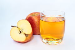 Fresh apples and a glass of apple juice Royalty Free Stock Photos