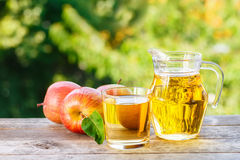 Apple juice in glass Royalty Free Stock Image