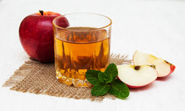 Apple juice. Glass of apple juice and fresh red apple Stock Images