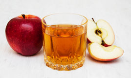 Apple juice. Glass of apple juice and fresh red apple Royalty Free Stock Images