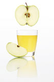 Apple juice in glass isolated on white Royalty Free Stock Photo