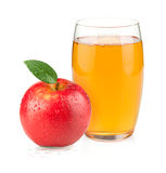 Apple juice in a glass and red apple Stock Photos