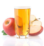 Apple juice in glass and slices on white Royalty Free Stock Images