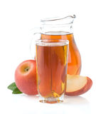 Apple juice in glass and slices on white Stock Photo