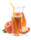 Apple juice in glass and slices on white Royalty Free Stock Photos