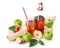 Apple juice in glass with straw royalty free stock photo