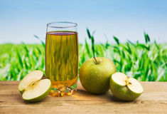 Apple juice in a glass on a table Royalty Free Stock Photography