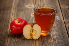 Apple juice. In glass on wooden background stock photo