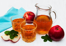 Apple juice. Glasses of apple juice and fresh red apple Royalty Free Stock Photos