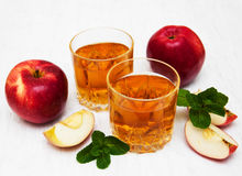 Apple juice. Glasses of apple juice and fresh red apple Royalty Free Stock Photo