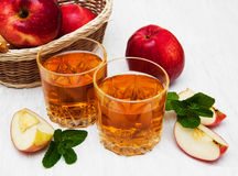 Apple juice. Glasses of apple juice and fresh red apple Stock Images