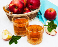 Apple juice. Glasses of apple juice and fresh red apple Royalty Free Stock Images