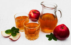 Apple juice. Glasses of apple juice and fresh red apple Stock Photo