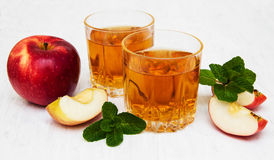 Apple juice. Glasses of apple juice and fresh red apple Stock Photography