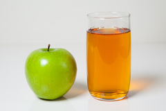 Apple juice and green apple Royalty Free Stock Images