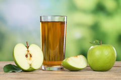 Apple juice and green apples in summer Royalty Free Stock Image