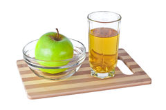 Apple and juice. Green apple and juice on cutting board Royalty Free Stock Image