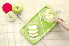 Apple juice healthy diet food with hand Stock Photography
