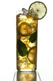Apple juice with ice cubs. On a wooden background Royalty Free Stock Photos