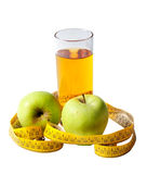Apple juice and measuring tape Royalty Free Stock Photography