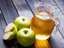 Apple juice in pitcher on wooden table still life Stock Photography