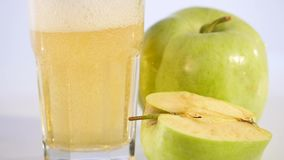 Apple juice is poured into a glass. Apple drink. Apple fresh stock video