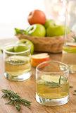 Apple juice with rosemary Stock Images