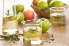Apple juice with rosemary Royalty Free Stock Photos