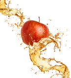 Apple and juice splash Royalty Free Stock Photography