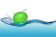 Apple in juice stream Royalty Free Stock Photos