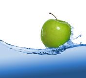 Apple in juice stream Stock Photography
