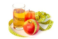 Apple and apple juice with tape measure on white background stock photo