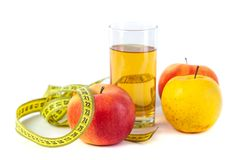 Apple and apple juice with tape measure on white background royalty free stock image