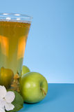 Apple juice and white flowers Stock Photos