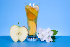 Apple juice and white flowers Royalty Free Stock Photos