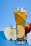 Apple juice and white flowers Royalty Free Stock Photography