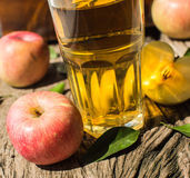 Apple juice on a wooden board Stock Photography