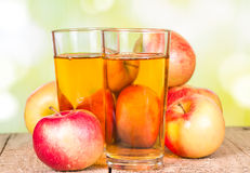 Apple juice on a wooden surface Stock Images