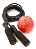 Apple and jump rope Royalty Free Stock Photos