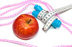 Apple and jump rope Royalty Free Stock Photo