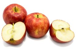 Apple Kanzi isolated. Red Kanzi apples, two whole, two halves, isolated on white backgroundn Stock Photos