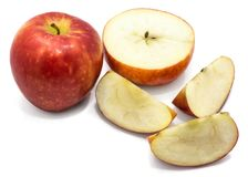 Apple Kanzi isolated. Sliced apples Kanzi, one whole, cross section half, slices, isolated on white backgroundn Stock Image